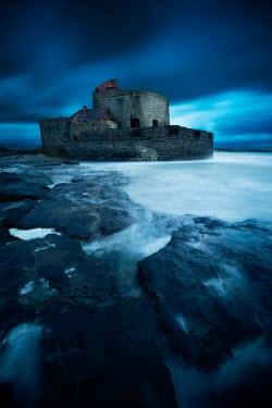 David Keochkerian STONE BUILDING WITH ROCKS AND MISTY SEA