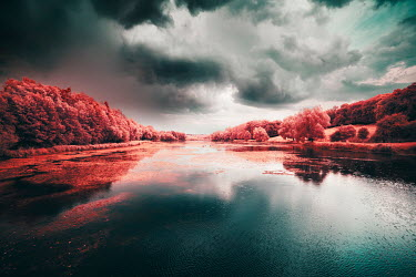 David Keochkerian RIVER WITH RED TREES AND STORMY SKY