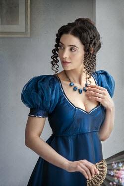 Lee Avison attractive brunette regency lady in a blue empire line dress