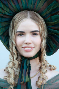 Lee Avison close up portrait of a pretty blond regency woman with ringlets and bonnet