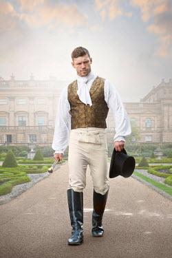 Lee Avison regency man walking towards camera mansion in background