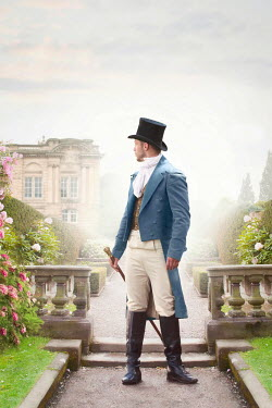 Lee Avison regency man looking back over grounds to a mansion