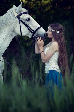 Carmen Spitznagel WOMAN STROKING HEAD OF WHITE HORSE OUTDOORS