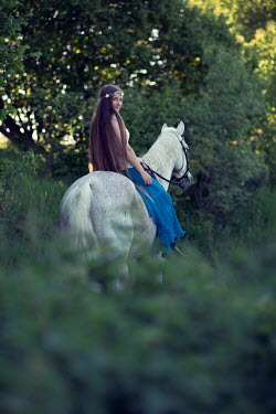 Carmen Spitznagel WOMAN IN WHITE ON HORSE IN COUNTRYSIDE