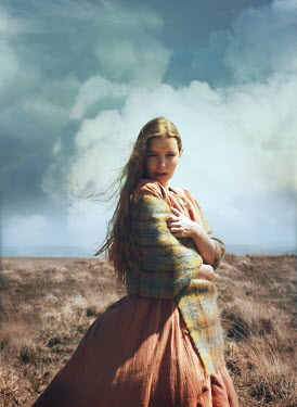 Mark Owen WOMAN WITH SHAWL STANDING IN COUNTRYSIDE