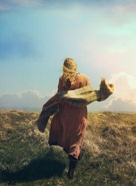 Mark Owen WOMAN WITH SHAWL WALKING ON MOORLAND