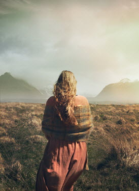 Mark Owen WOMAN WITH SHAWL ON MOORLAND WITH MOUNTAINS