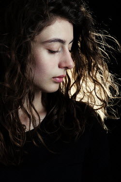 Magdalena Russocka close up of young woman with blowing dark hair inside