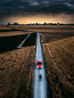Magdalena Russocka man by car on empty country road from above