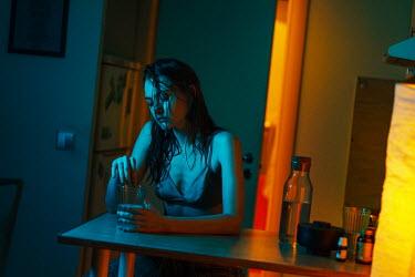 Maria Yakimova SAD GIRL SITTING IN KITCHEN AT NIGHT