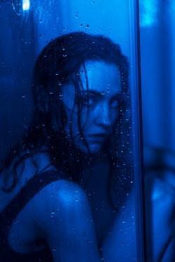 Maria Yakimova WORRIED WOMAN BEHIND DOOR IN SHOWER