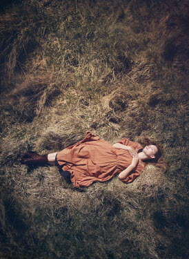 Mark Owen WOMAN LYING ON GRASS RELAXING