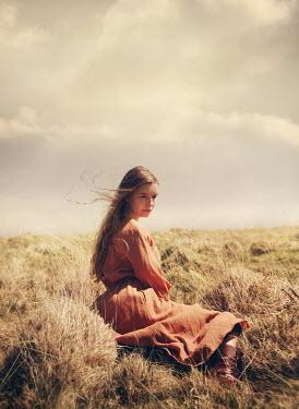 Mark Owen THOUGHTFUL BRUNETTE GIRL SITTING IN COUNTRYSIDE