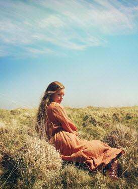 Mark Owen GIRL LYING ON GRASS IN COUNTRYSIDE