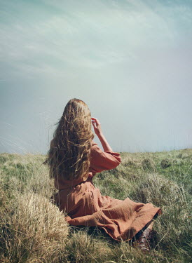 Mark Owen GIRL WITH LONG HAIR SITTING IN COUNTRYSIDE