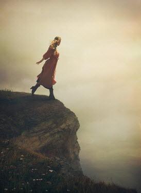 Mark Owen WOMAN WALKING BY EDGE OF CLIFF