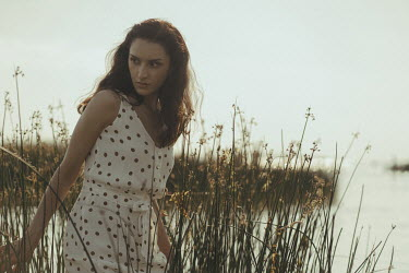 Maria Yakimova WOMAN WITH DARK HAIR STANDING BY LAKE