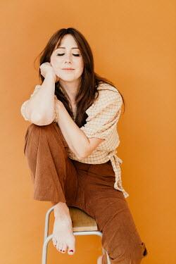 Shelley Richmond HAPPY DAYDREAMING WOMAN SITTING ON STOOL