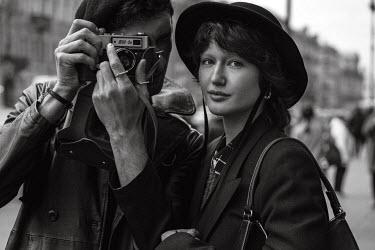 Maria Yakimova MALE PHOTOGRAPHER AND WOMAN IN MODERN CITY