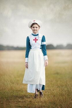 Anna Buczek HISTORICAL NURSE WALKING IN FIELD