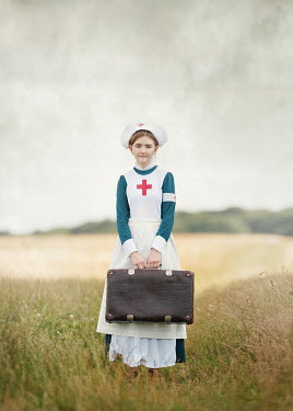 Anna Buczek HISTORICAL NURSE WITH SUITCASE IN FIELD