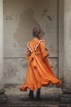 Anna Buczek YOUNG GIRL WITH ORANGE DRESS BY SHABBY BUILDING