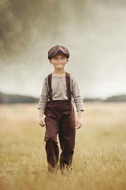 Anna Buczek YOUNG BOY IN CAP WALKING IN FIELD