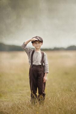 Anna Buczek YOUNG BOY IN CAP WATCHING IN FIELD
