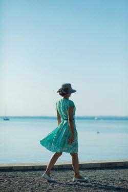Ildiko Neer Young woman walking by sea