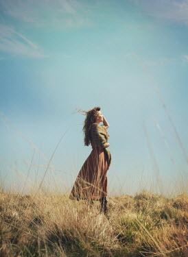 Mark Owen BRUNETTE GIRL WITH SHAWL STANDING IN FIELD