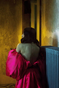 Marta Syrko ASIAN WOMAN IN PINK GOWN INDOORS AT NIGHT