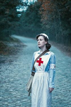 Natasza Fiedotjew vintage nurse standing on cobbled pavement