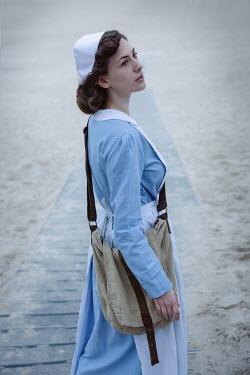 Natasza Fiedotjew war nurse standing on beach by sea