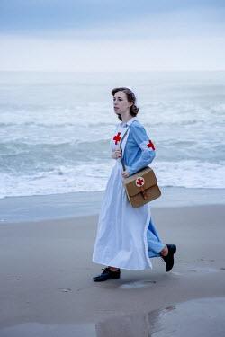 Natasza Fiedotjew vintage nurse walking by sea