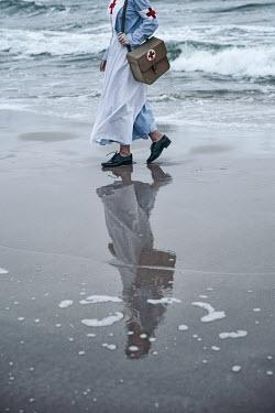 Natasza Fiedotjew reflexion of vintage nurse walking by sea