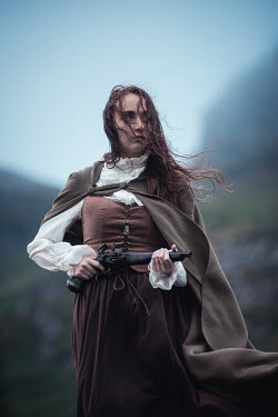 Marie Carr HISTORICAL WOMAN IN CAPE HOLDING PISTOL OUTDOORS