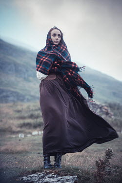 Marie Carr WOMAN WITH SHAWL STANDING IN WINDY COUNTRYSIDE