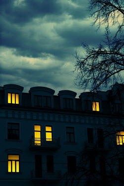 Magdalena Russocka historical townhouse with lights in windows at night