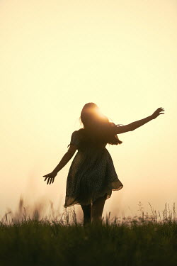Magdalena Russocka teenage girl running in field at sunset