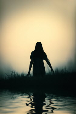 Magdalena Russocka teenage girl walking by river at sunset