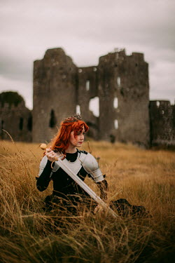 Rebecca Stice WOMAN BY RUINED CASTLE IN ARMOUR WITH SWORD