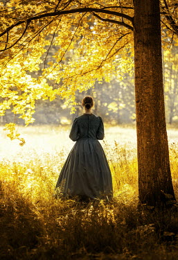 Jaroslaw Blaminsky HISTORICAL WOMAN BY TREE IN GOLDEN COUNTRYSIDE