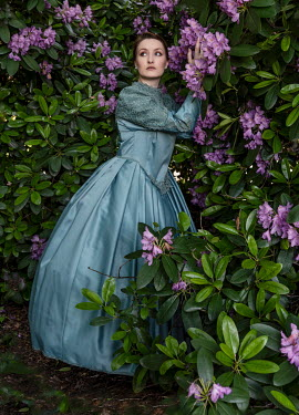 Jaroslaw Blaminsky HISTORICAL WOMAN BY RHODODENDRONS OUTDOORS