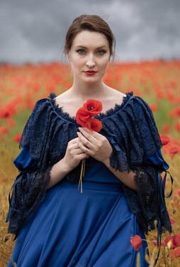 Jaroslaw Blaminsky HISTORICAL BRUNETTE WOMAN IN POPPY FIELD