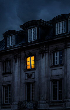 Jaroslaw Blaminsky LIGHT IN WNDOW OF HISTORICAL BUILDING AT DUSK