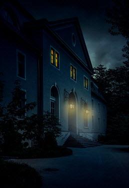 Jaroslaw Blaminsky LARGE HISTORICAL GRAND BUILDING WITH LIGHTS AT DUSK