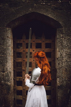 Rebecca Stice MEDIEVAL WOMAN HOLDING SWORD OUTSIDE CASTLE