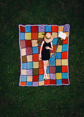 Isabelle Lafrance GIRL LYING ON BLANKET WITH HAT AND GUITAR