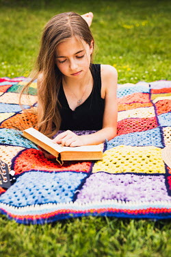 Isabelle Lafrance GIRL LYING ON BLANKET WITH GUITAR READING BOOK