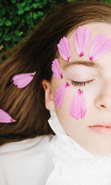 Isabelle Lafrance YOUNG GIRL SLEEPING WITH PINK PETALS ON FACE